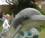 Bella climbing Dolphin sculture