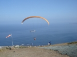 Paraglider lifts off from Signal Hill
